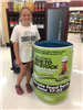 Little Girl Next to Food Donation Bin